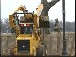 Soldiers set-up Hesco barriers in Fargo to hold back flood waters.