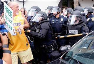 Police push a man during a demonstration outside a rally held by Republican presidential candidate Donald Trump in San Diego, California, on May 27, 2016. JONATHAN ALCORN / Reuters