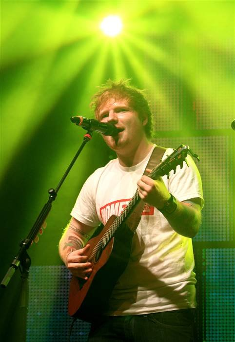 English singer songwriter Ed Sheeran performs in concert at the Carpenter Center at the University of Delaware on Sept. 18, 2013. Owen Sweeney / AP