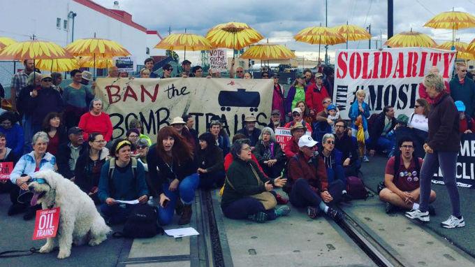 Protesters form human blockade along rail tracks