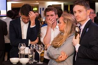 Remain supporters react as the EU referendum results are announced at the Royal Festival Hall in London on Friday
