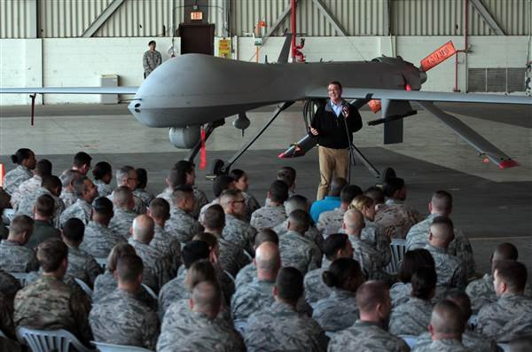 U. S. Defense Secretary Ash Carter addresses U.S. troops as he stands in front of a drone at the Incirlik Air Base near Adana, Turkey, Tuesday, Dec. 15, 2015. AP