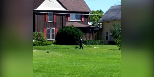 Police officer stays to finish mowing the lawn after a medical c ...