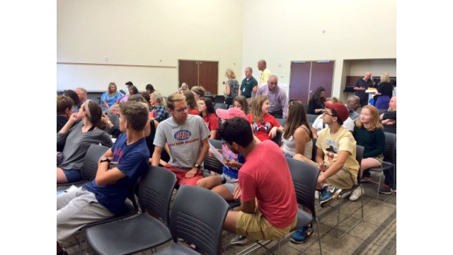 Washington High School students and parents gather at school board meeting.