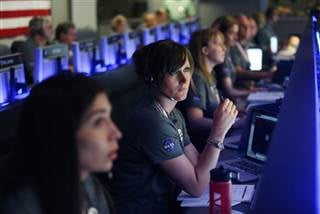 Staff members watch on before the solar-powered Juno spacecraft went into orbit around Jupiter, at NASA's Jet Propulsion Laboratory in Pasadena, California on July 4, 2016. RINGO CHIU / Pool via AFP - Getty Images