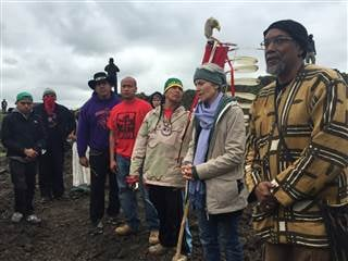 In this photo provided by LaDonna Allard, Green Party presidential candidate Jill Stein, second from right, participates in an oil pipeline protest, Tuesday, Sept. 6, 2016 in Morton County, North Dakota LaDonna Allard / via AP