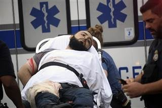 Ahmad Khan Rahami is taken into custody after a shootout with police Monday, Sept. 19, 2016, in Linden, N.J. Nicolaus Czarnecki / AP