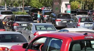 Motorists wait in line for gas at a Costco store Wednesday in Altamonte Springs, Fla. Joe Burbank - Orlando Sentinel via AP