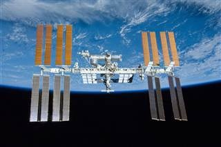 The International Space Station orbits around Earth in 2010. NASA via AP file