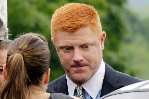 (AP Photo/Gene J. Puskar, File). FILE - In this June 12, 2012, file photo, former Penn State University assistant football coach Mike McQueary arrives at the Centre County Courthouse in Bellefonte, Pa.