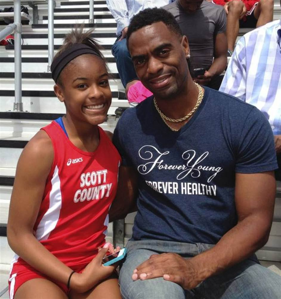 Trinity Gay with her father Tyson Gay in Georgetown, Kentucky, on May 3, 2014. Mark Maloney / Lexington Herald-Leader via AP
