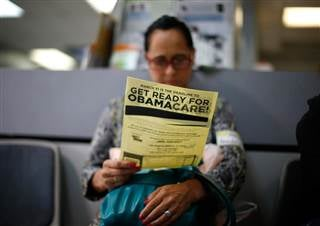 Arminda Murillo, 54, reads a leaflet at a health insurance enrollment event in Cudahy, California LUCY NICHOLSON / Reuters, file