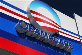 An Obamacare sign on the UniVista Insurance company office in Miami, Florida. Today, Joe Raedle / Getty Images