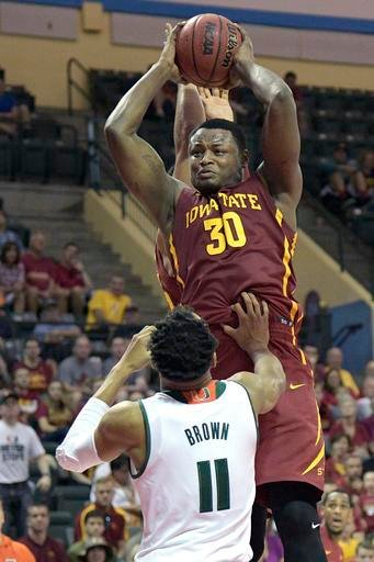 Iowa State guard Deonte Burton (30) grabs a rebound over Miami guard Bruce Brown (11) during the second half of an NCAA college basketball game at the AdvoCare Invitational tournament in Lake Buena Vista, Fla., Friday, Nov. 25, 2016. Iowa State won 73-56.