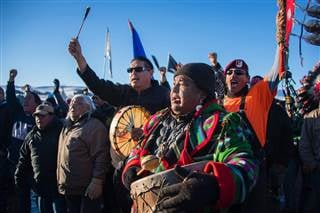 Activists celebrate at Oceti Sakowin Camp on the edge of the Standing Rock Sioux Reservation on Sunday.December 4, 2016 outside Cannon Ball, North Dakota. The Army Corps of Engineers on Sunday notified the Standing Rock Sioux that the current route for th