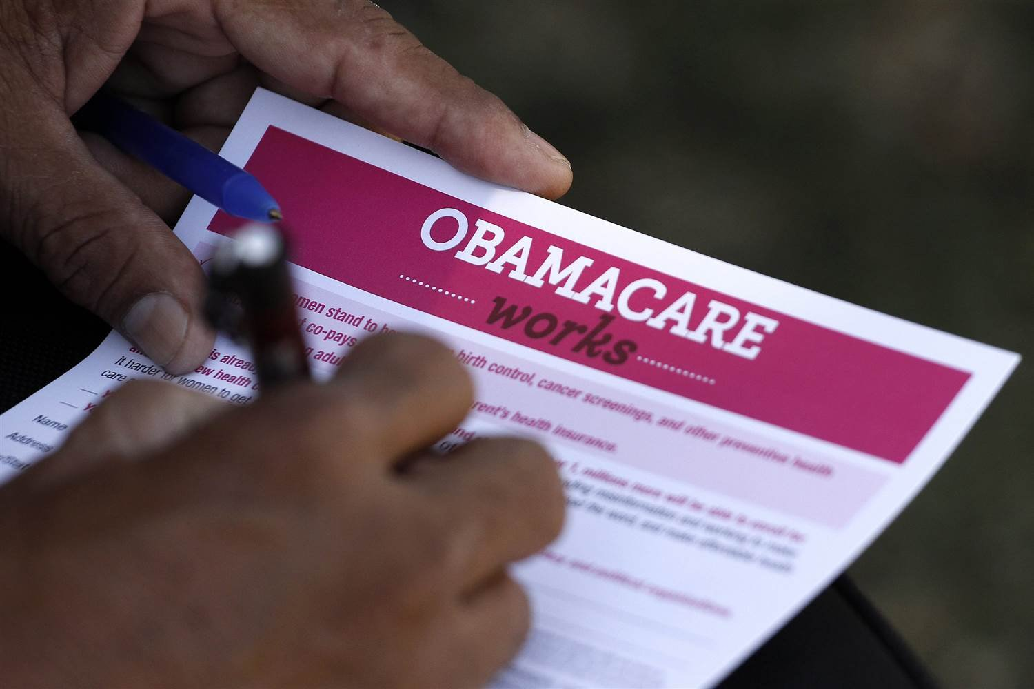 A man fills out an information card during an Affordable Care Act outreach event. JONATHAN ALCORN / Reuters file
