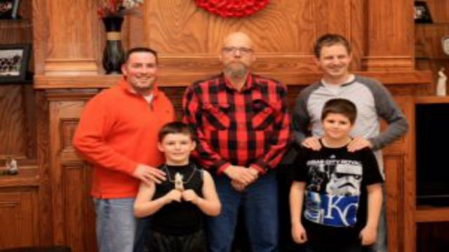 Damian Bell, left, with his son, Konnor; Richard G. Rauzi, center; and eyewitness Jesse Bannor and his son, Ethan.