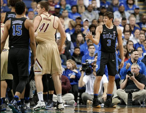 (AP Photo/Chuck Burton). Duke's Grayson Allen (3) reacts after being called for a foul from tripping a Elon player in the first half of an NCAA college basketball game in Greensboro, N.C., Wednesday, Dec. 21, 2016.