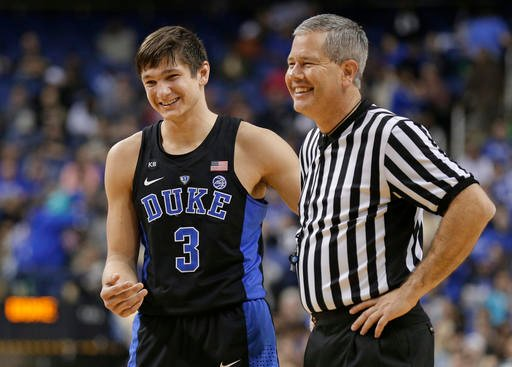 (AP Photo/Chuck Burton). Duke's Grayson Allen (3) shares a laugh with an official in the second half of an NCAA college basketball game against Elon in Greensboro, N.C., Wednesday, Dec. 21, 2016. Duke won 72-61.