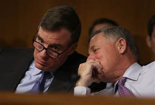 Sen. Mark R. Warner, Vice Chair of the Senate Select Committee on Intelligence, and Sen. Richard Burr, Chairman of the Senate Select Committee on Intelligence, speak during the Senate Intelligence Committee on Capitol Hill on Jan. 10 in Washington, D.C. J