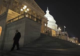 A member of the U.S. House of Representatives walks down the steps from the House Chamber JIM BOURG / Reuters