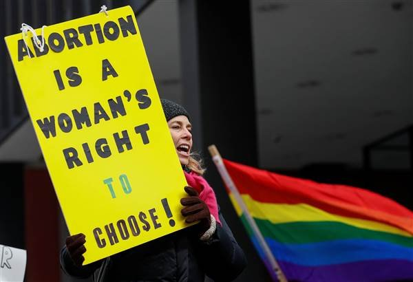 Anti-Trump demonstrator protests at abortion rights rally in Chicago on Jan. 15, 2017. Kamil Krzaczynski / Reuters
