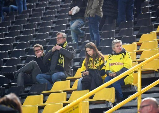 (AP Photo/Federico Gambarini/dpa via AP). Borussia Dortmund fans sit in the Signal Iduna Park in Dortmund, Germany, Tuesday, April 11, 2017. The first leg of the Champions League quarter final soccer match between Borussia Dortmund and AS Monaco had be...