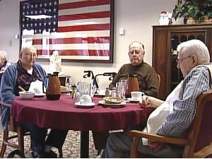 WWII veterans Karl Wirzbach, Ken Evers and Verdus Burr eat lunch at Bethany Home in Dubuque.