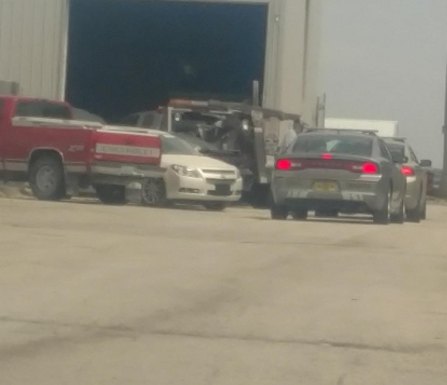 State Patrol investigators have arrived at Roadside Towing and Collision in Winthrop to inspect the vehicles in last night's crash.