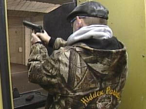 Mike Engling fires his handgun at Dubuque's Central Range