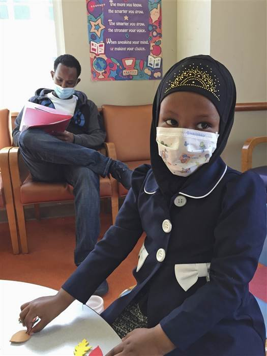 Amira Hassan, of Burnsville, Minn., wears a mask to protect herself from measles at the specialty clinic at Children's Minnesota in Minneapolis. Amy Forliti / AP