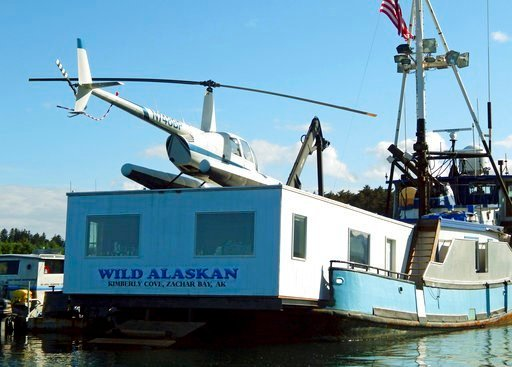(Kodiak Daily Mirror via AP, File). FILE - This 2014 file photo, shows the Wild Alaskan, a converted crabbing boat that had been used as a strip club, moored near downtown Kodiak, Alaska.