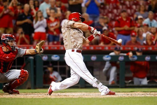 (AP Photo/John Minchillo). Cincinnati Reds' Scooter Gennett hits a two-run home run and his fourth overall in the eighth inning of a baseball game against the St. Louis Cardinals, Tuesday, June 6, 2017, in Cincinnati. The Reds won 13-1.