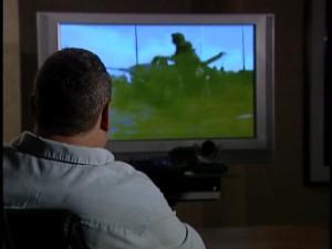 Larry Bathen watching Gulf War video