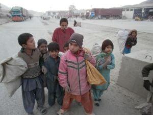 Children gathered around Rew in Torkham, Afghanistan