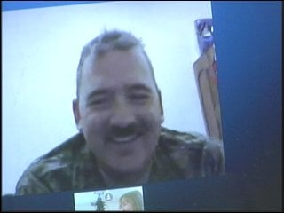 Sergeant First Class Mark Blakeman communicates with family.