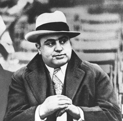 (AP Photo/File). FILE - In this Jan. 19, 1931 file photograph, Chicago mobster Al Capone is seen at a football game in Chicago. Artifacts connected to some of the nation's most notorious gangsters are being auctioned this weekend.
