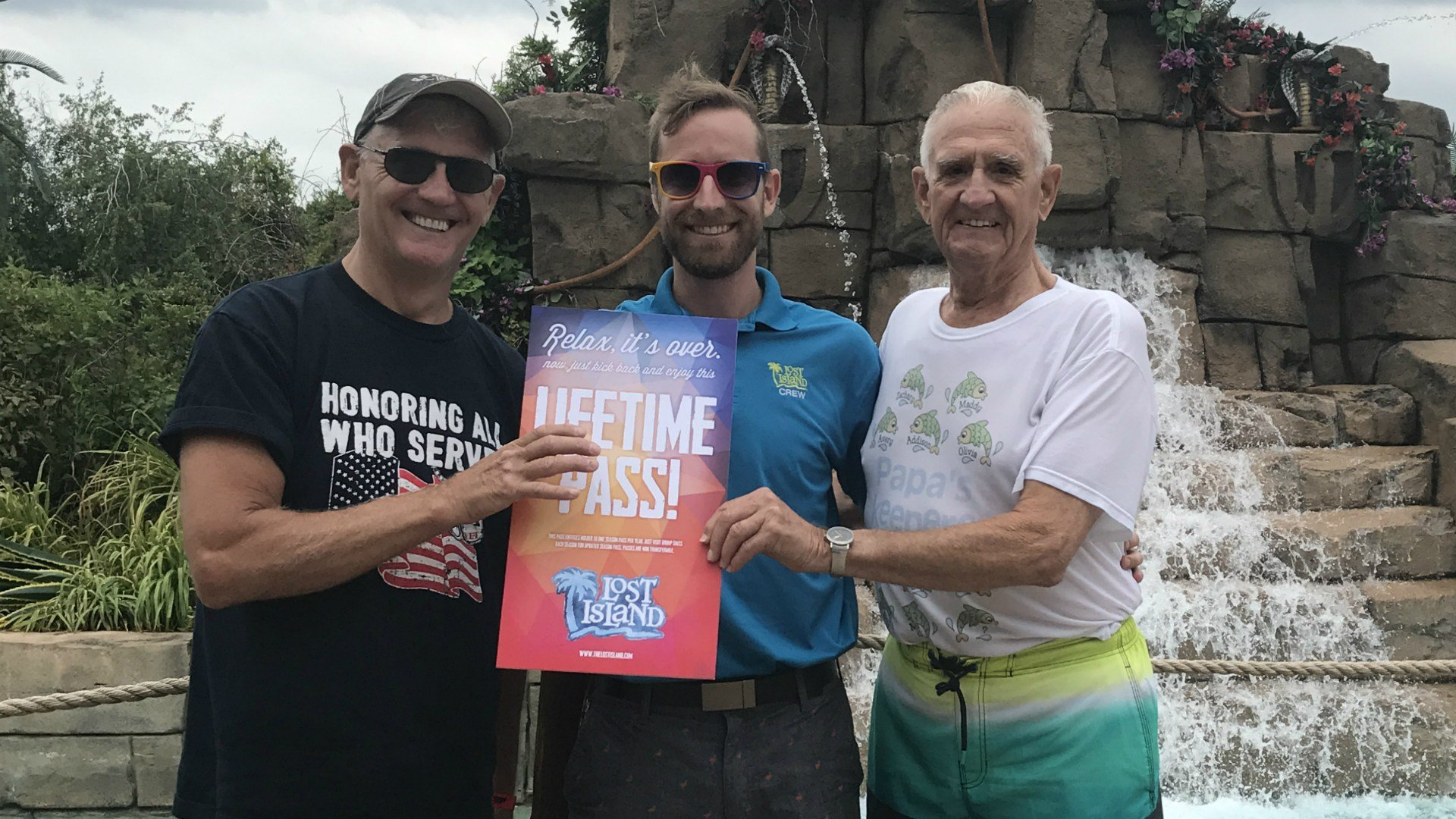 Pete Brustkern (right) passes a Lifetime Season Pass to Randy Miller (right) with Lost Island General Manager Eric Bertch (center)