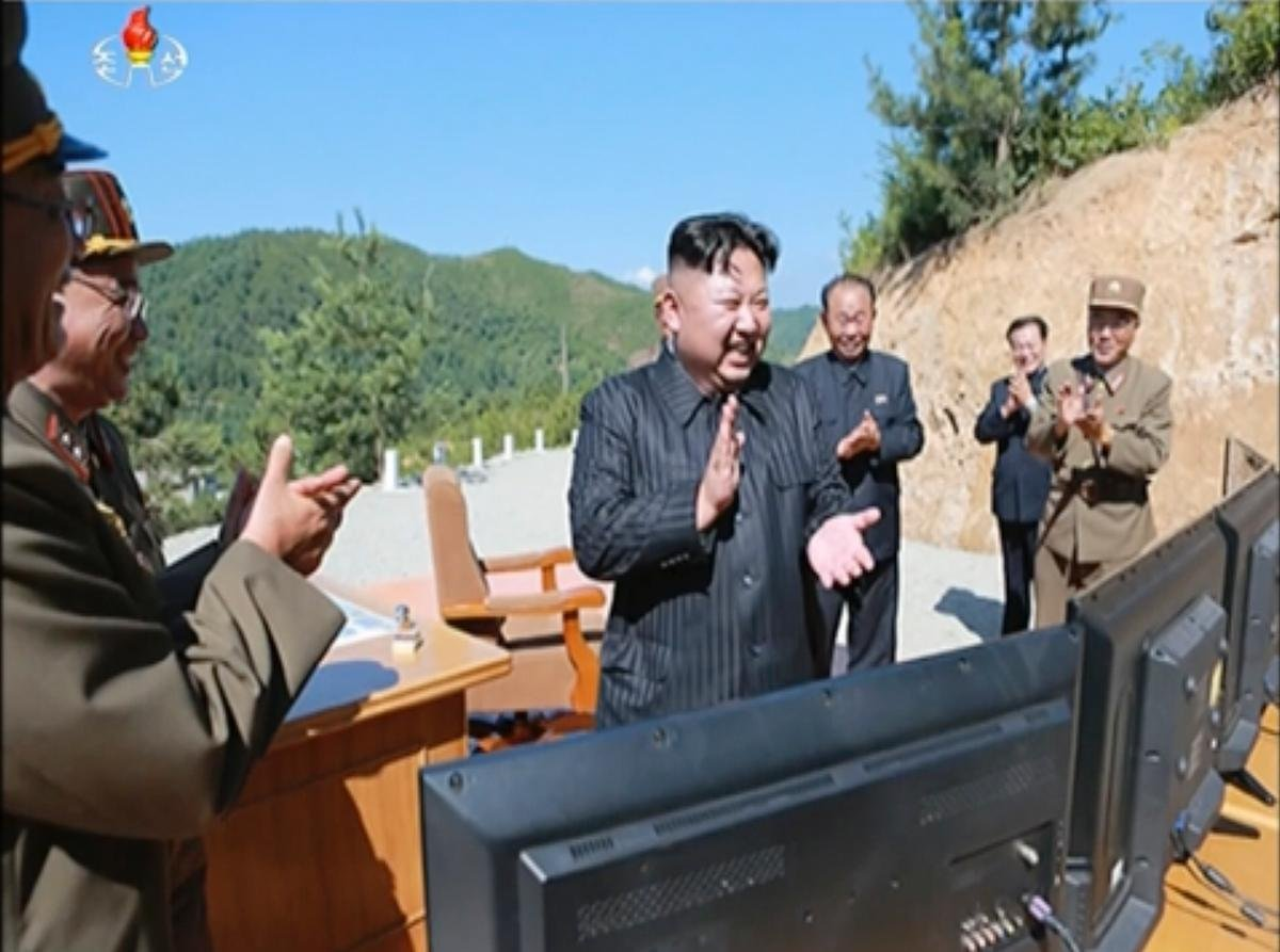 This image made from video of a news bulletin aired by North Korea's KRT on Tuesday, July 4, 2017, shows what was said to be North Korea leader Kim Jung Un, center, applauding after the launch of a Hwasong-14 ballistic missile, ICBM.  (KRT via AP video)