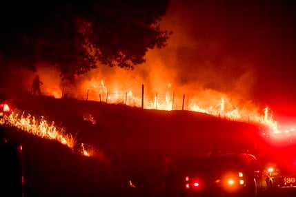 Flames from a backfire burn as CalFire crews battle the Ditwiler Fire near Mariposa, Calif., on Tuesday, July 18, 2017. Record rain and snowfall in the mountains this winter was celebrated for bringing California's five-year drought to its knees, but it h