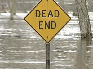 Street signs pepper the Mississippi River flood water's surface in an East Dubuque, Ill. neighborhood
