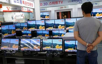 In this July 6, 2017 file photo, a man watches TV screens in an electronics shop showing a news program's report on North Korea's missile firing in Seoul, South Korea. North Korea fired a ballistic missile Friday night, July 28, which landed in the ocean