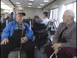 Glenn and Ardell Moeller wait to board their direct flight to Houston, TX