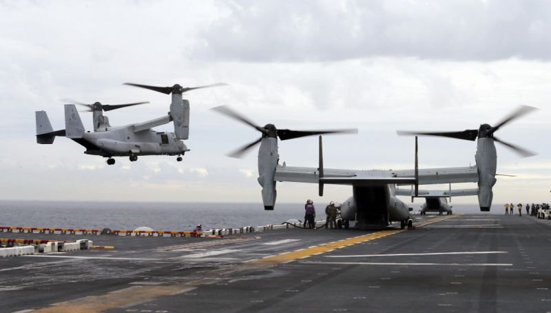 In this June 29, 2017 file photo U.S. Marine MV-22B Osprey aircraft land on the deck of the USS Bonhomme Richard amphibious assault ship off the coast from Sydney during events marking the start of Talisman Saber 2017 (Jason Reed/Pool Photo via AP, File)