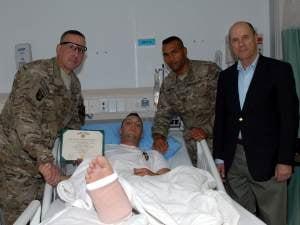 SGT Chisum Frisch receives the Purple Heart