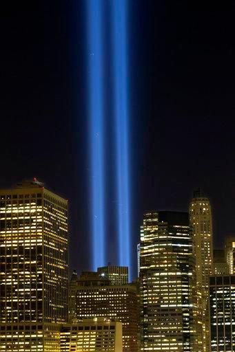 he Tribute in Light rises above the lower Manhattan skyline, Sunday, Sept. 10, 2017, in New York. The two blue pillars of light provide a visual reminder of how the Twin Towers, destroyed in the terrorist attacks of Sept. 11, 2001, once stood above the ci