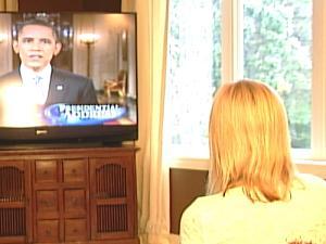 Cheryl Billmyer, mother of Cpl. Christopher Billmyer, watches President Obama's address Wednesday evening