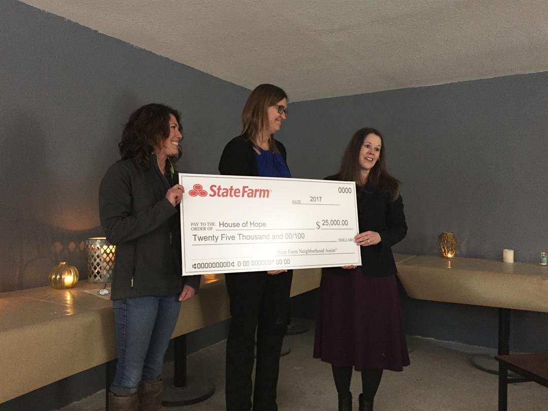 Sandy Benak presents the check to House of Hope's Karin Rowe and Dusky Steel