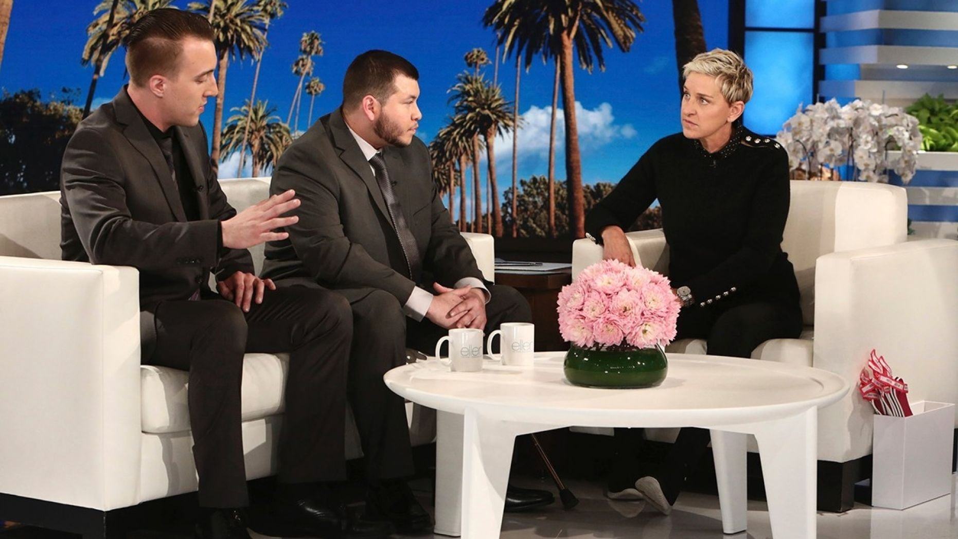 "In this Oct. 17, 2017, photo released by Warner Bros., Stephen Schuck, left, and Jesus Campos appear with host Ellen Degeneres during a taping of ""The Ellen DeGeneres Show"" at the Warner Bros. lot in Burbank, Calif. (Photo by Michael Rozman/Warner Bros.)"