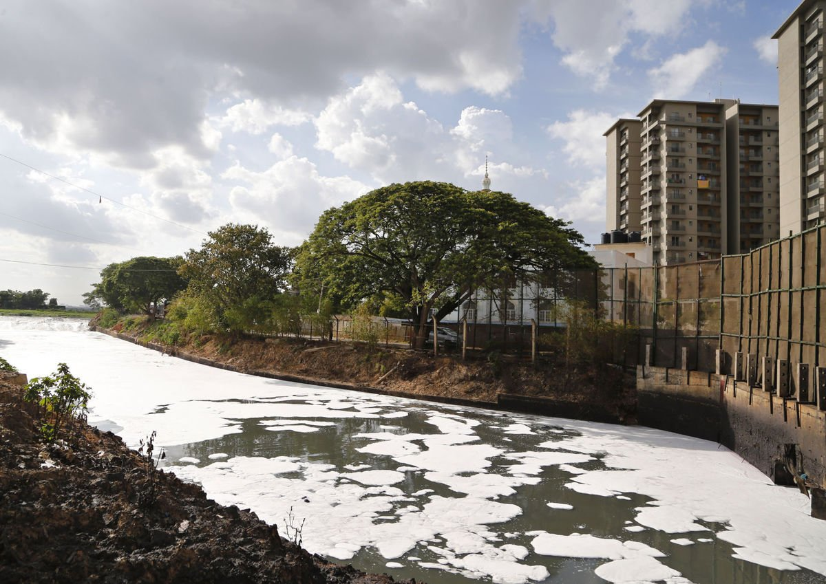 FILE - In this June 5, 2017, file photo, toxic froth from industrial pollution floats on Bellundur Lake on World Environment Day, in Bangalore, India. (AP Photo/Aijaz Rahi, File)